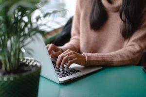 woman writing a grant proposal