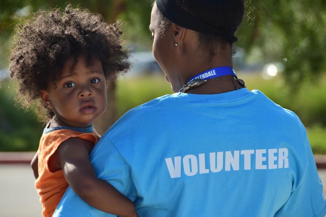 volunteer holding a child