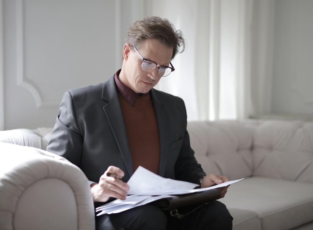 man reviewing grant proposals