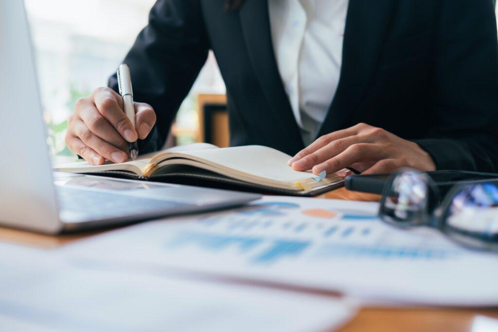 businessman writing grant proposal