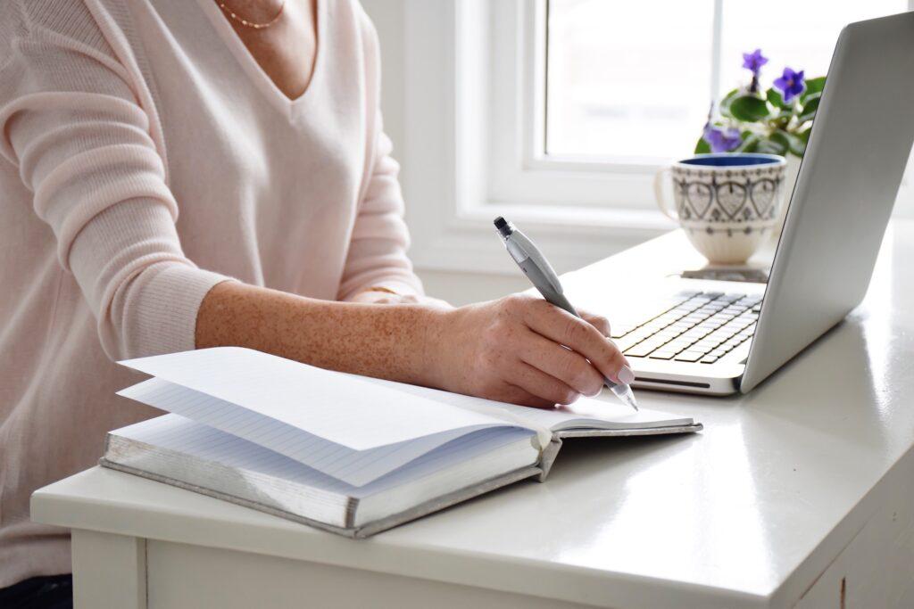 businesswoman writing grant proposal