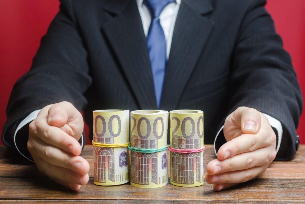 man holding money symbolizing government grants funding